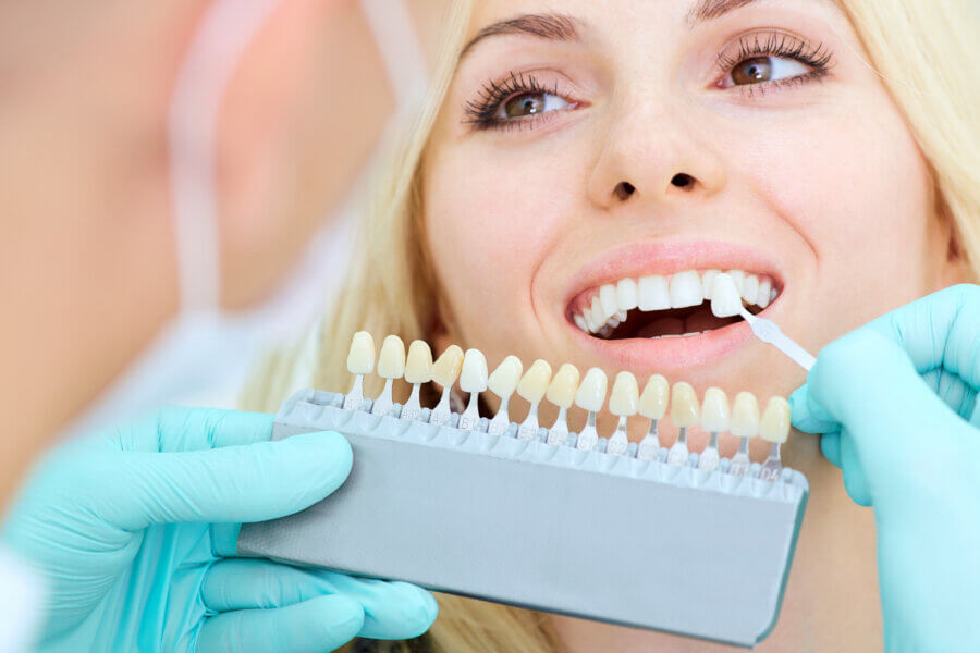 dental crown Closeup of a girl with a beautiful smile at the dentist.  Dental care concept